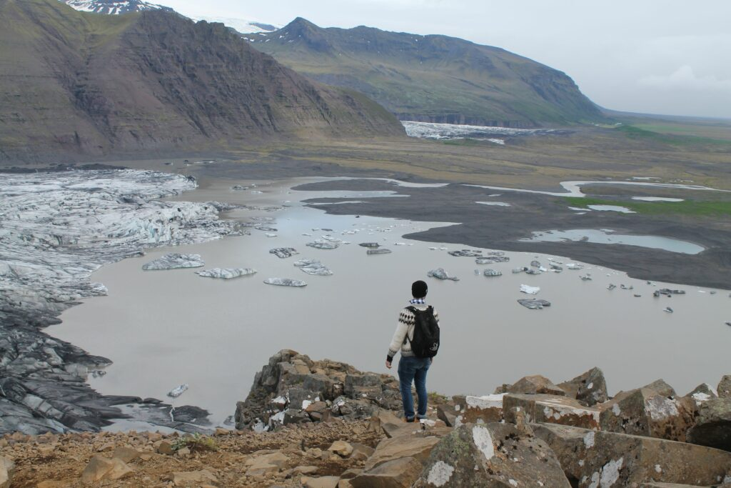 man standing looking at Sjónarnípa viewing point in Skaftafell Nature Reserve