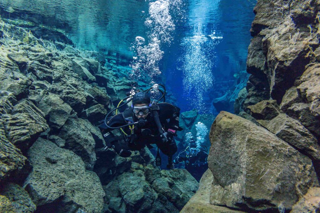 two people Diving in Silfra in Thingvellir National Park