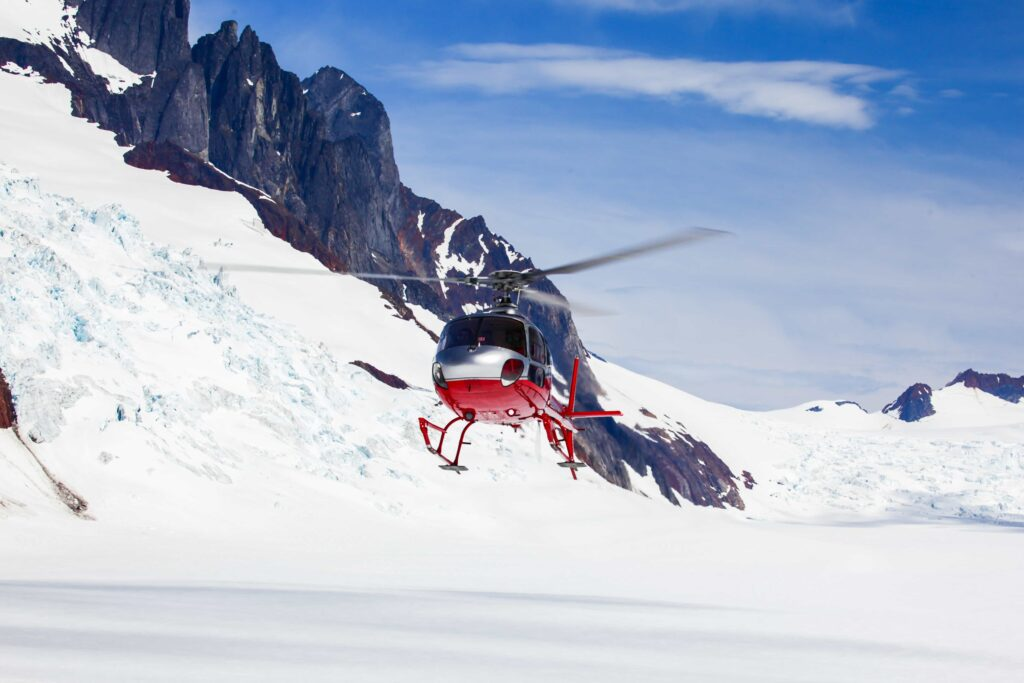 Helicopter landing on a glacier in Iceland