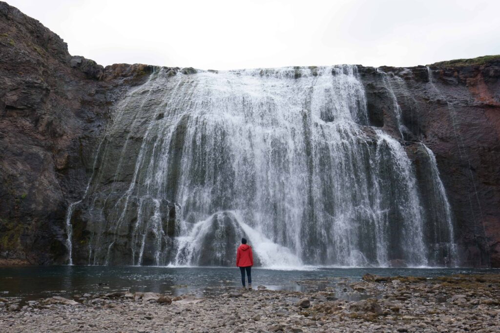 woman standing in front of Þórufoss waterfall in the Golden Circle in Iceland