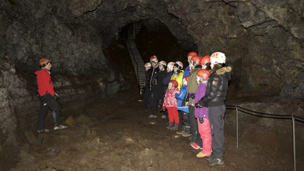people on a tour in Vatnshellir lava cave in Snæellsnes Peninsula