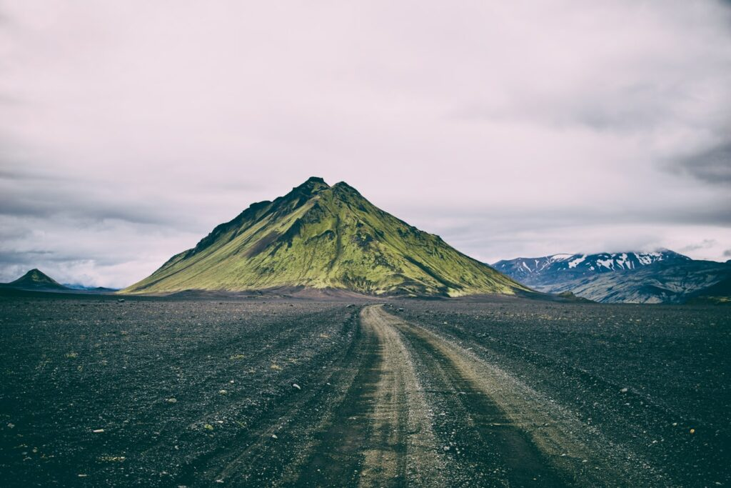 Self Driving road trip next to Mælifell volcano in the Highlands of Icelan