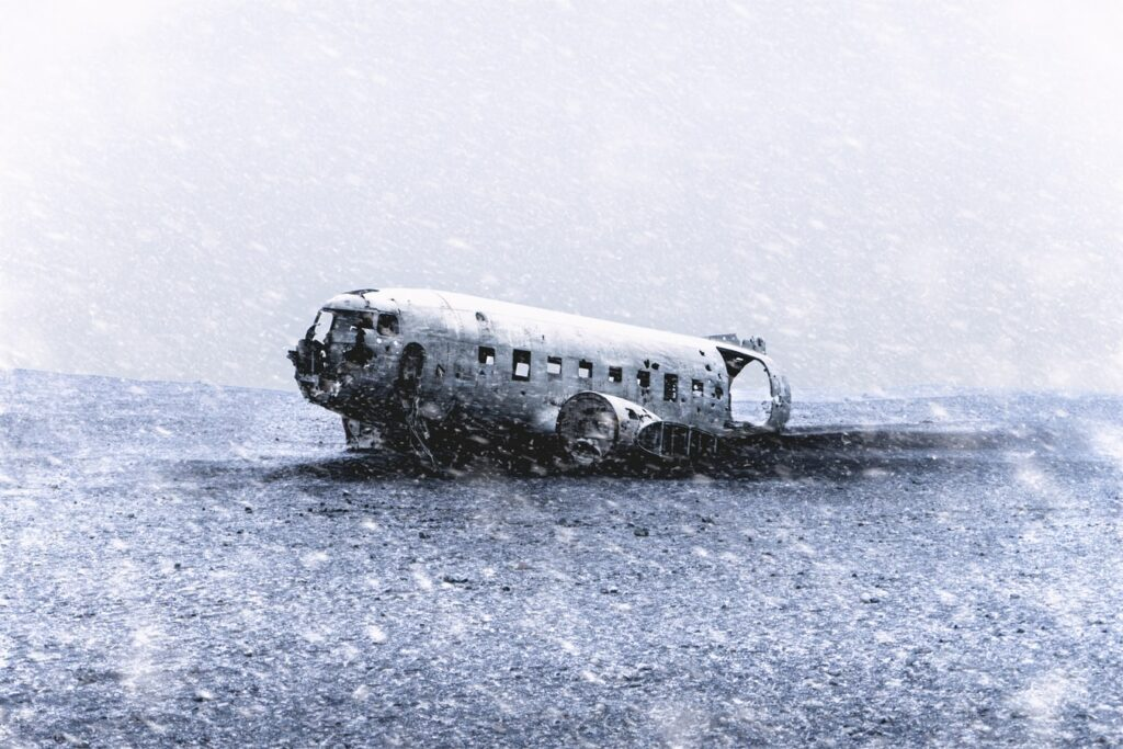 snow falling at Solheimasandur Plane Wreck in south Iceland
