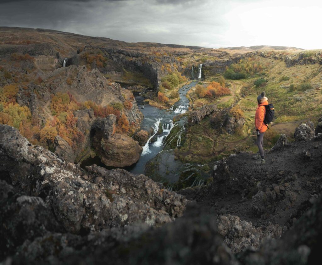 man standing in front of Gjain in thjorsardalur golden circle in Iceland