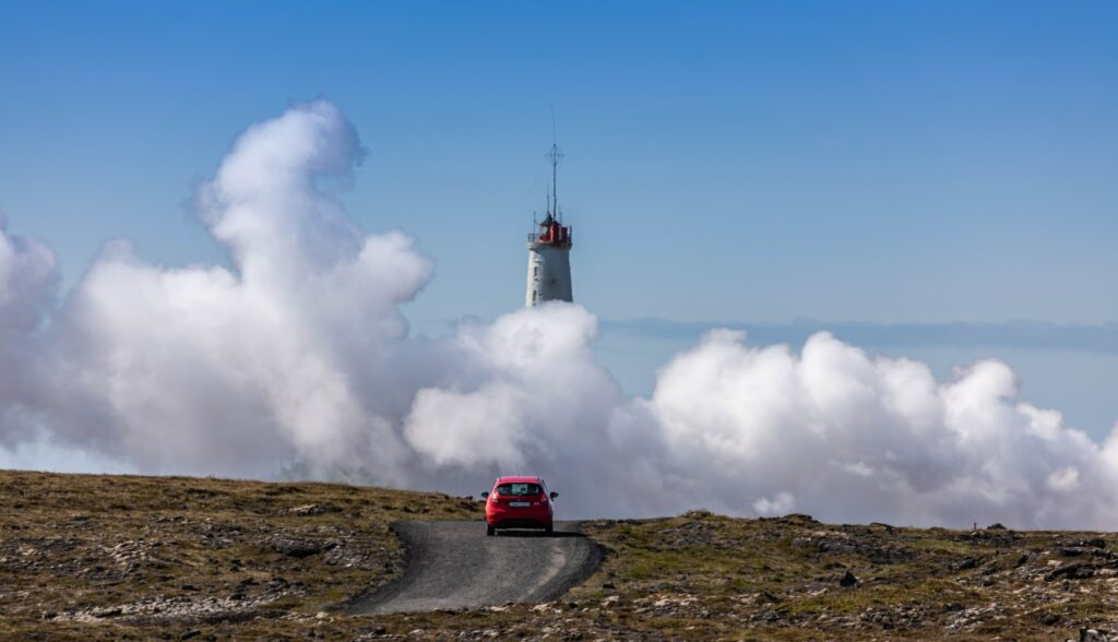 car driving in front of Gunnuhver hot spring in Reykjanes Peninsula Iceland