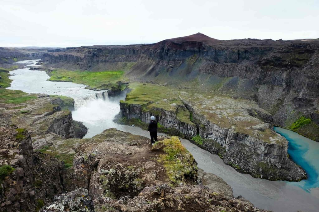 man standing on the viewpoint at Hafragilsfoss waterfall in the diamond circle in north Iceland