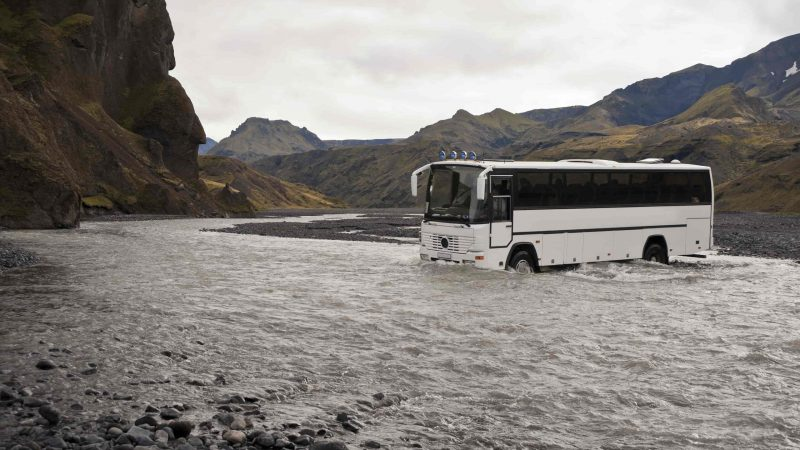 bus crossing a river on the way to Þórsmörk in the highlands of Iceland