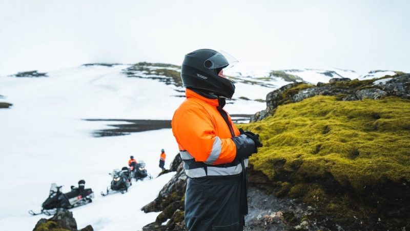 people on Eyjafjallajokull snowmobile tour with views of green moss