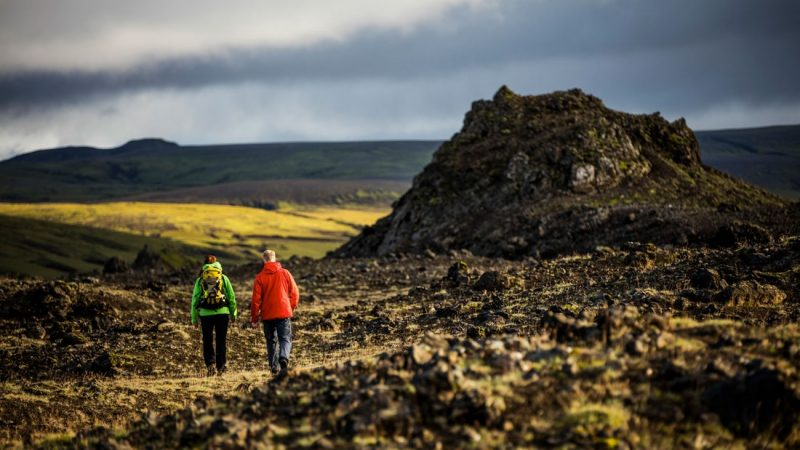 Two people hiking Þrihyrningur mountain in south Iceland