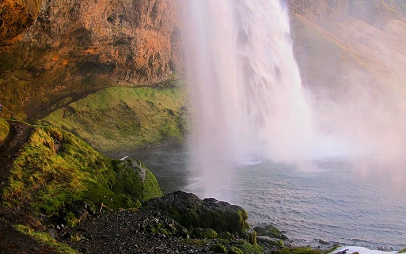 walking behind Seljalandsfoss waterfall in south Iceland