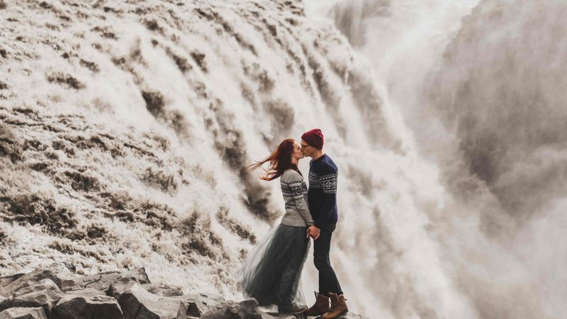 couple kissing in front of Dettifoss the most powerful waterfall in Europe, wedding photo shoot in Iceland