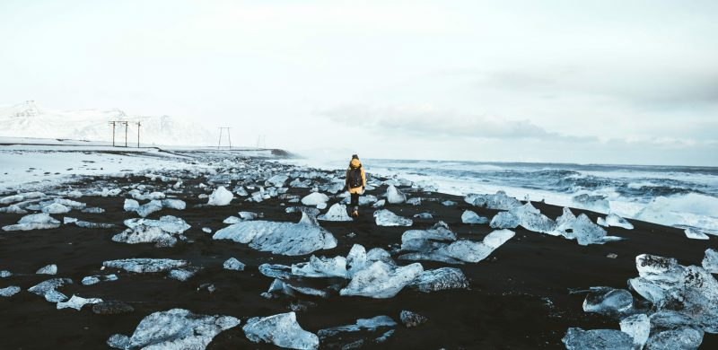 man walking on the Diamond Beach in south Iceland