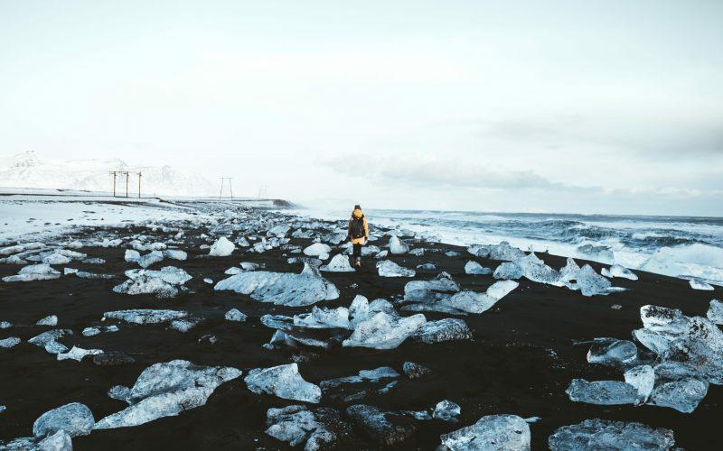 man walking on the Diamond Beach in south Iceland