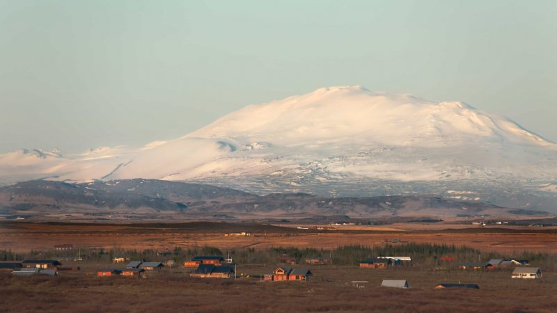 summer houses in front of Eyjafjallajokull volcano and mountain in Iceland