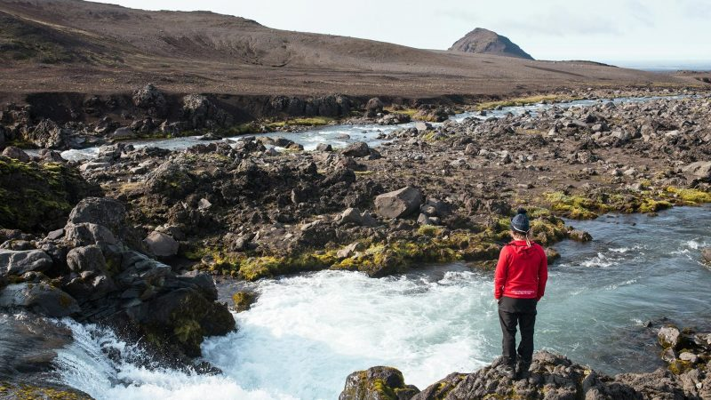 man standing in front of a river on Highland Super Jeep Excursion in south Iceland