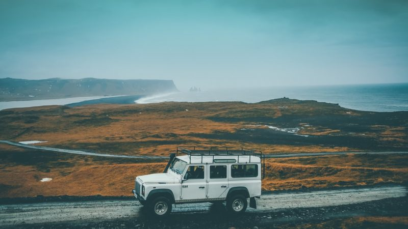 white jeep on a road trip in Iceland