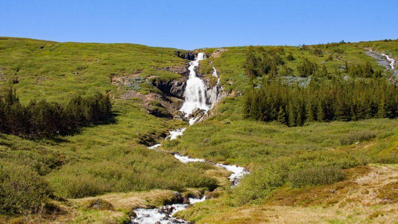 waterfall in Ísafjörður village in westfjords of Iceland