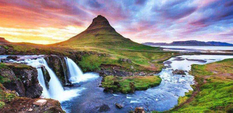 Kirkjufell mountain and Kirkjufellsfoss waterfall at sunset in Snæfellsnes Peninsula