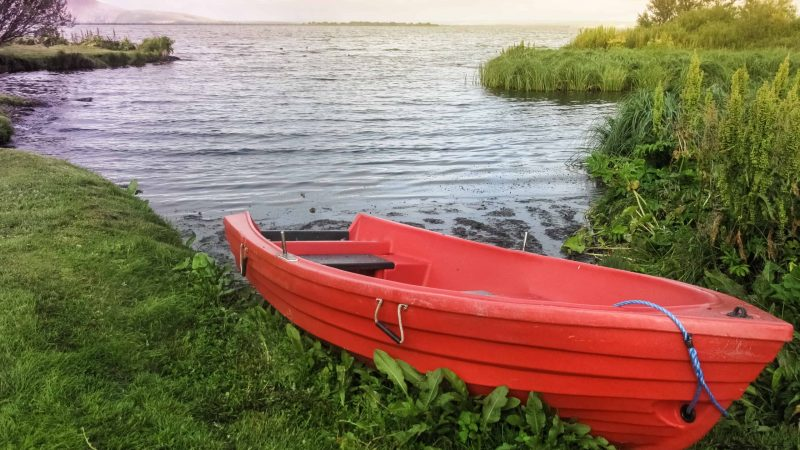 red boat in Lake Myvatn in North Iceland