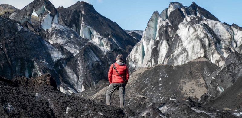 man standing in front of Solheimajokull glacier in south Iceland