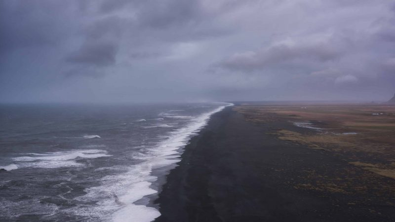 view over the black sand beach and ocean from Dyrhólaey cliffs in south Iceland