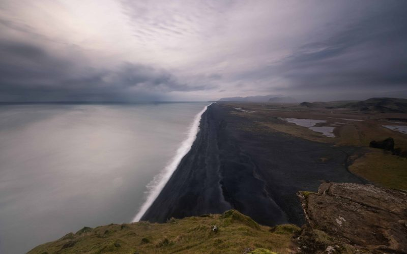 View over the black sand beach seen from Dyrhólaey cliffs in south Iceland