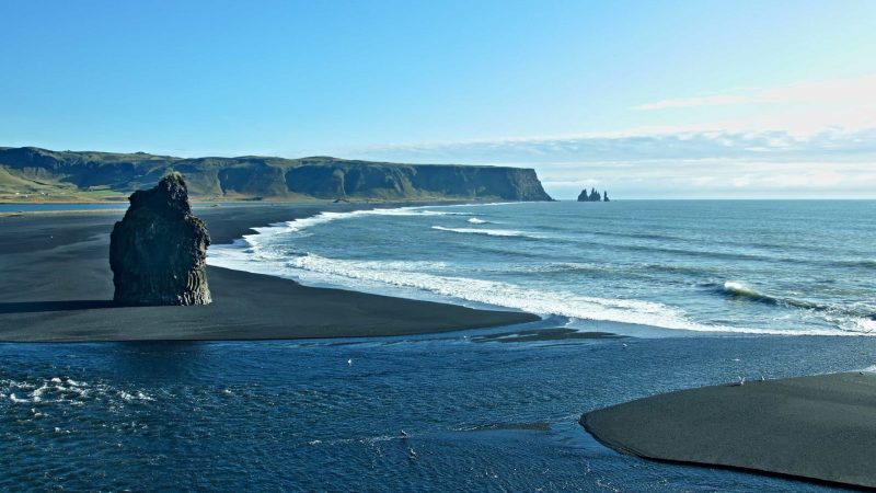 View over Reynisfjara and Kirkjufjara black sand beaches and Reynisdrangar cliffs seen from Dyrhólaey