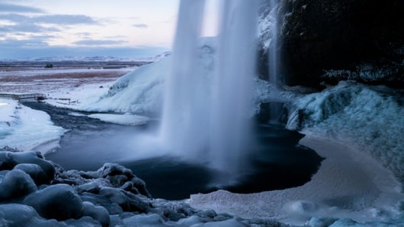 Seljalandsfoss waterfall with snow during winter in Iceland