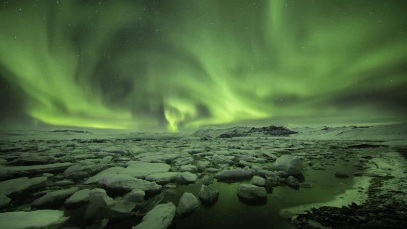 northern lights over Jokulsarlon glacier lagoon in south Iceland