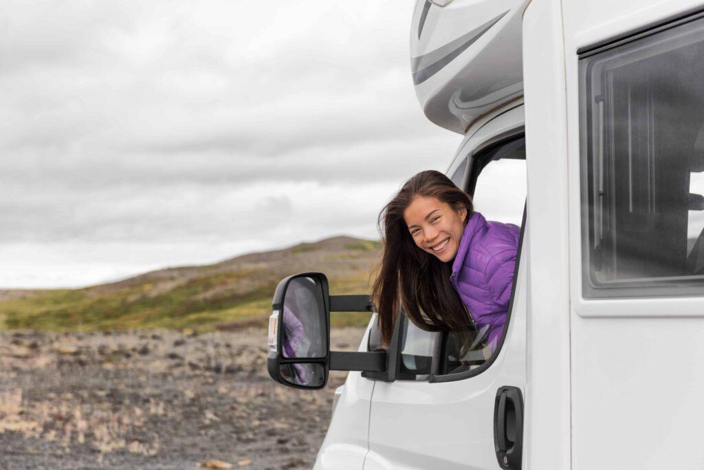 woman on a Camper van road trip in Iceland