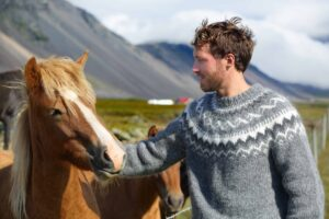 The Icelandic Horse and a man in an Icelandic wool sweater