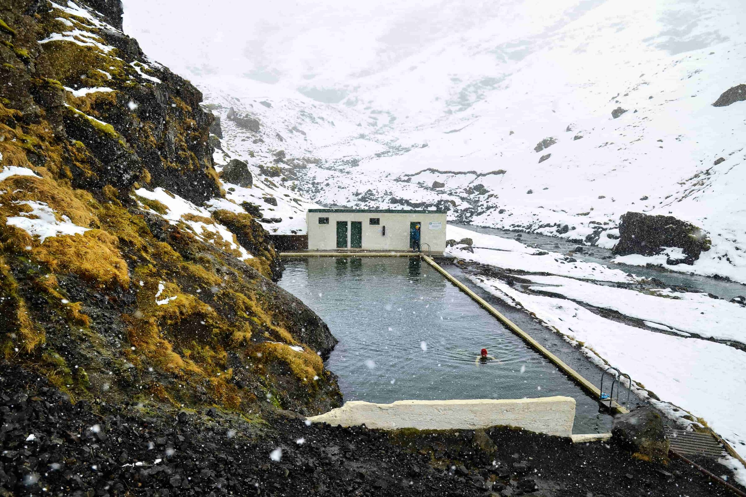 Seljavallalaug natural swimming pool in south Iceland in winter