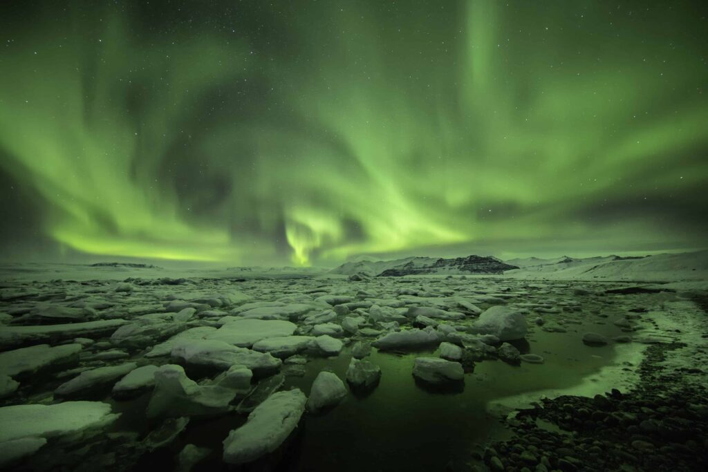 northern lights over Jokulsarlon glacier lagoon in south Iceland