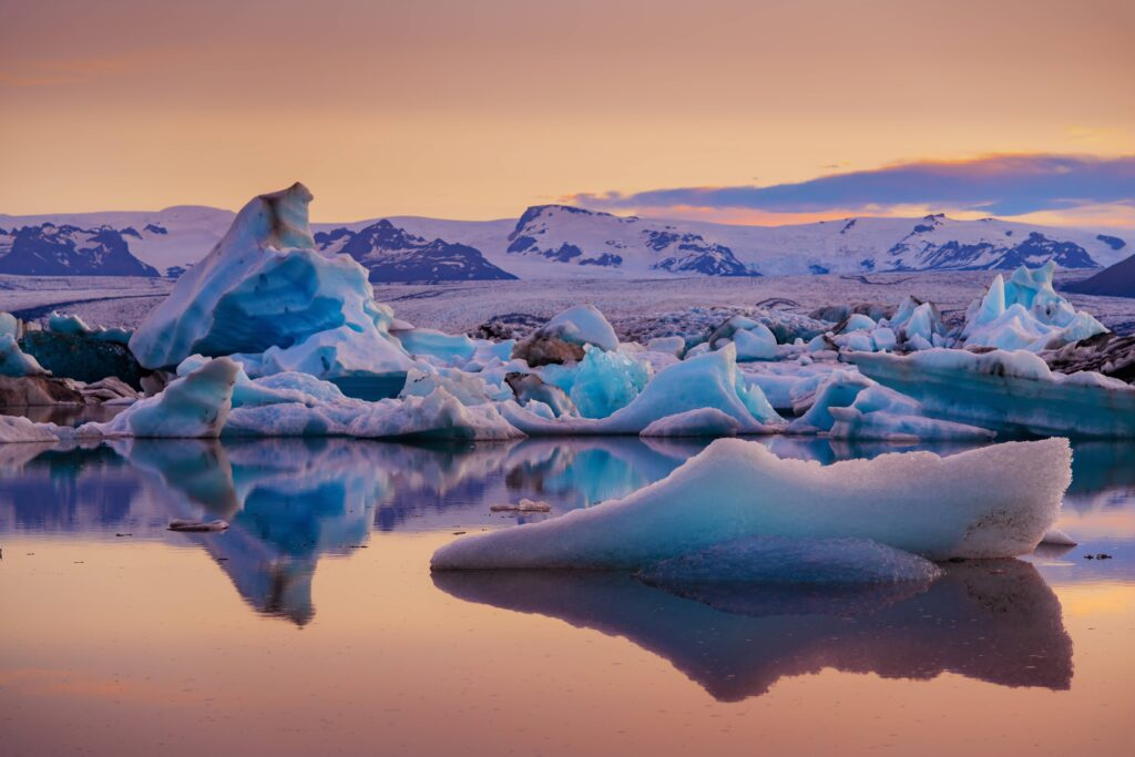Midnight sun at Jokulsarlon glacier lagoon in south Iceland