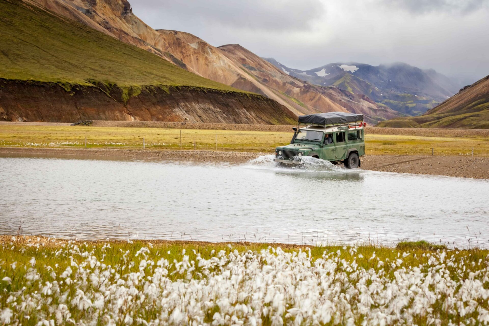 jeep driving over rivers in Landmannalaugar in the highlands of Iceland