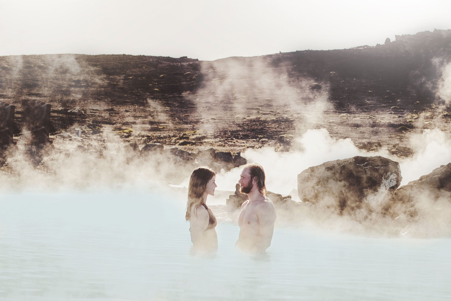 a couple in Myvatn Nature Baths in north Iceland