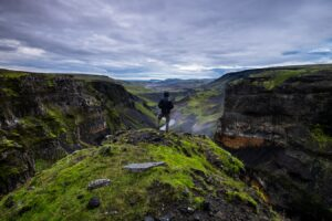 man standing at Háifoss waterfall in Golden Circle Iceland