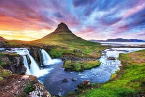 Kirkjufell mountain and Kirkjufellsfoss waterfall at sunset in Snæfellsnes Peninsula