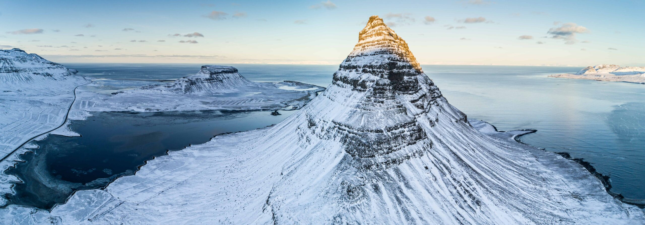 Kirkjufell mountain seen from above with snow during winter