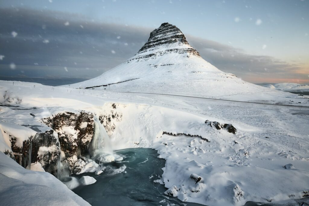 Kirkjufell mountain and Kirkjufell waterfall in Snæfellsnes during winter with snow
