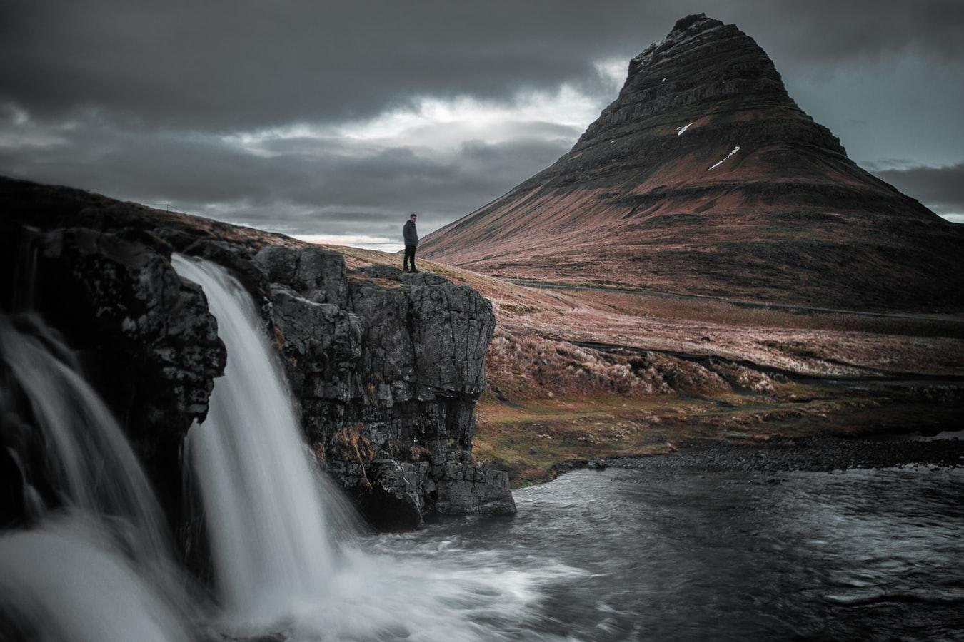 Kirkjufellsfoss waterfall and Kirkjufell mountain in the background
