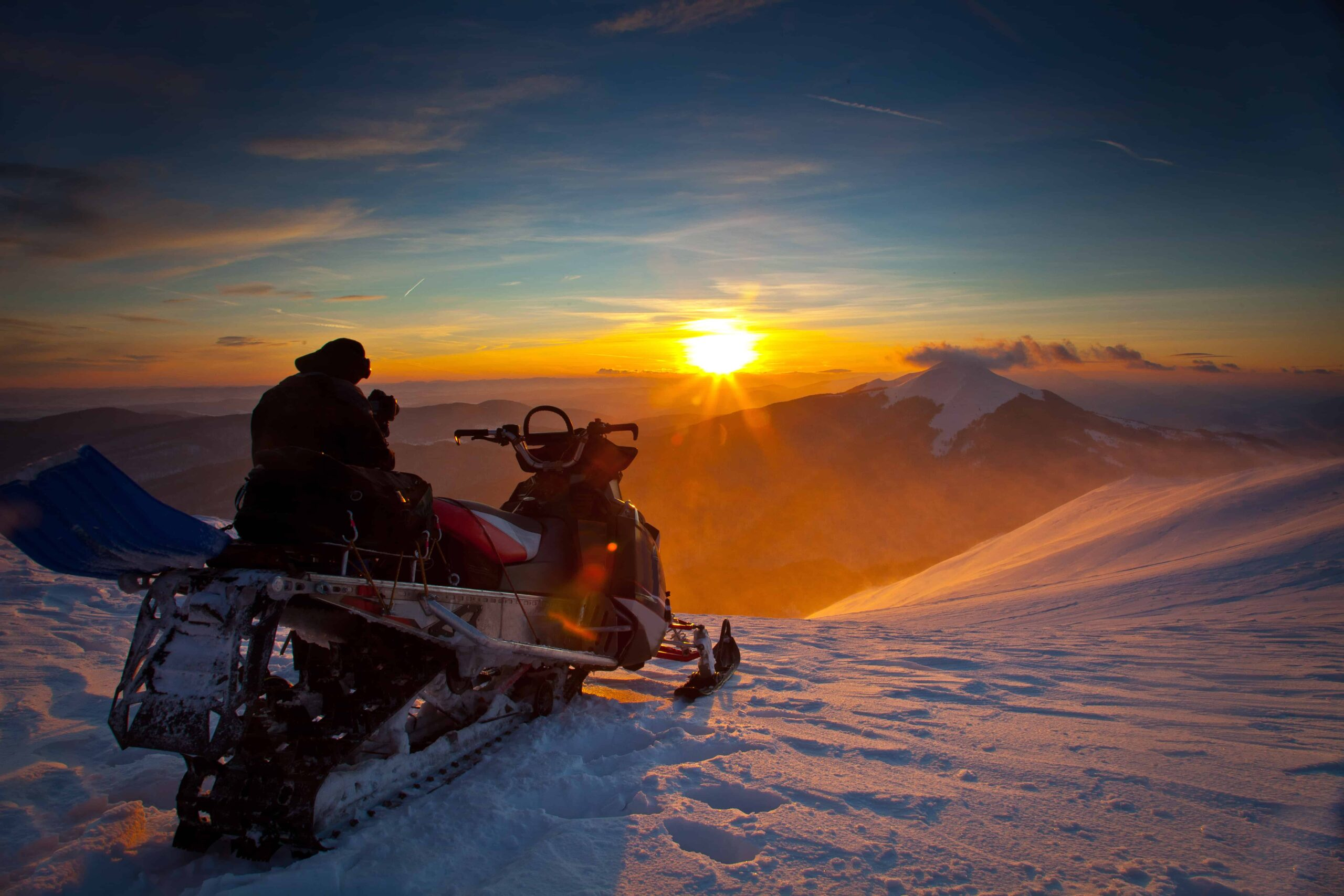 sunset and snowmobiling on a glacier in Iceland