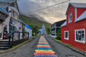 Seyðisfjörður, rainbow street and blue church in Seyðisfjordur village in east Iceland