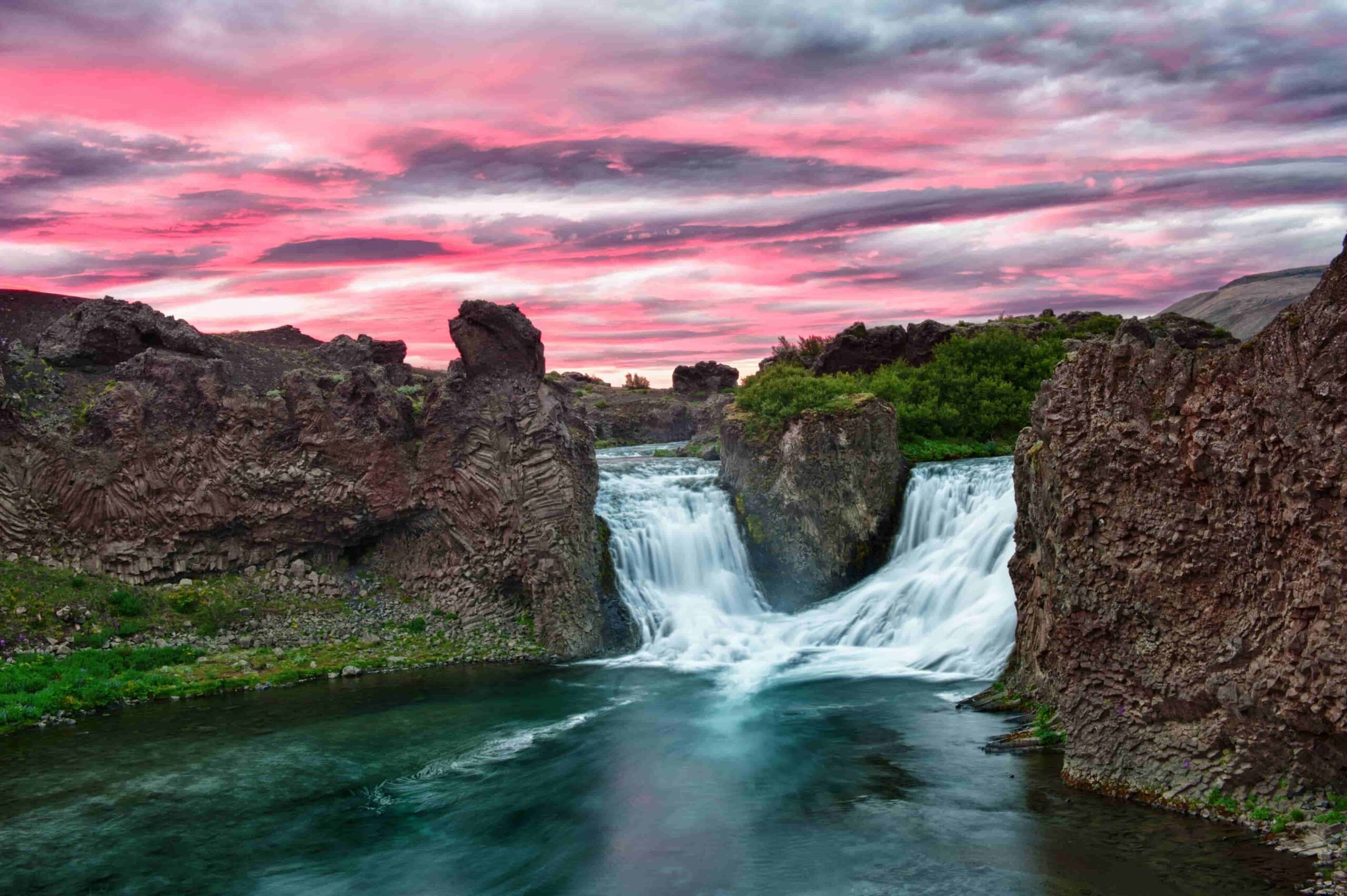 sunset at Hjálparfoss waterfall in the Golden Circle Highlands of Iceland