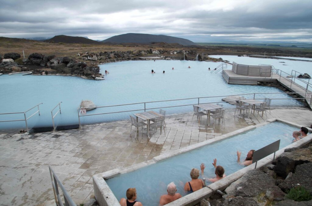 people relaxing in Myvatn Nature baths in north Iceland