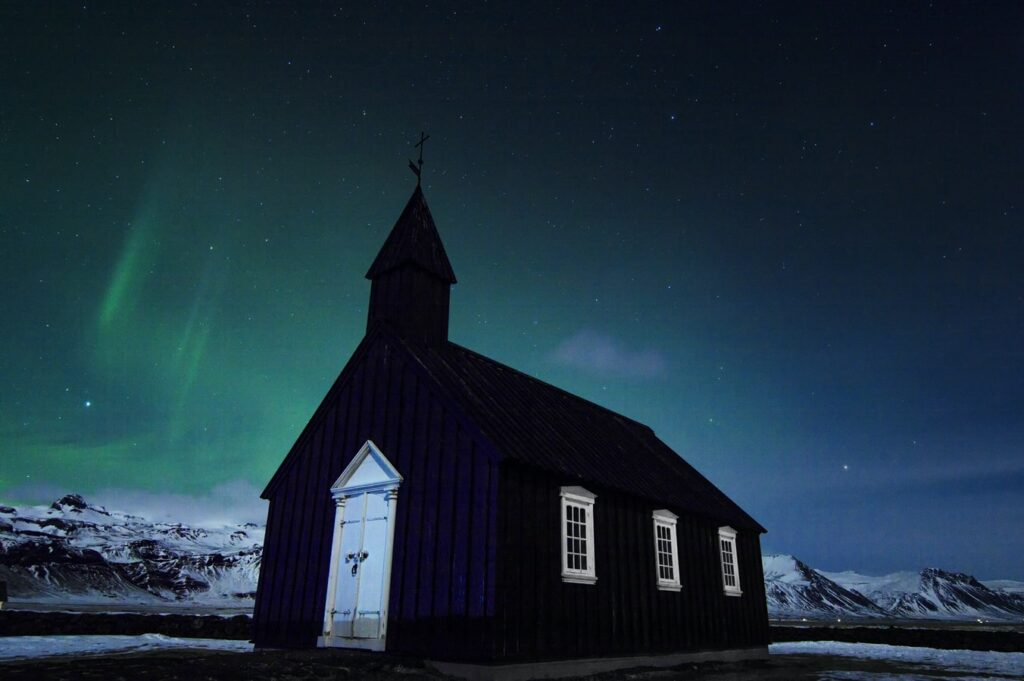 northern lights over Búðarkirkja black church in Búðir Snæfellsnes