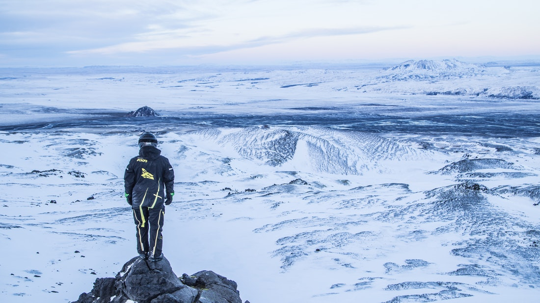 Man on Eyjafjallajokull snowmobile tour with views over the highlands of Iceland