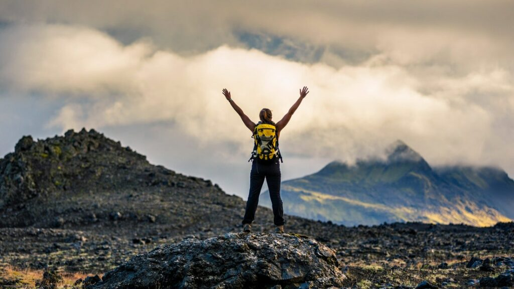 Man on top after hiking Þrihyrningur mountain in south Iceland