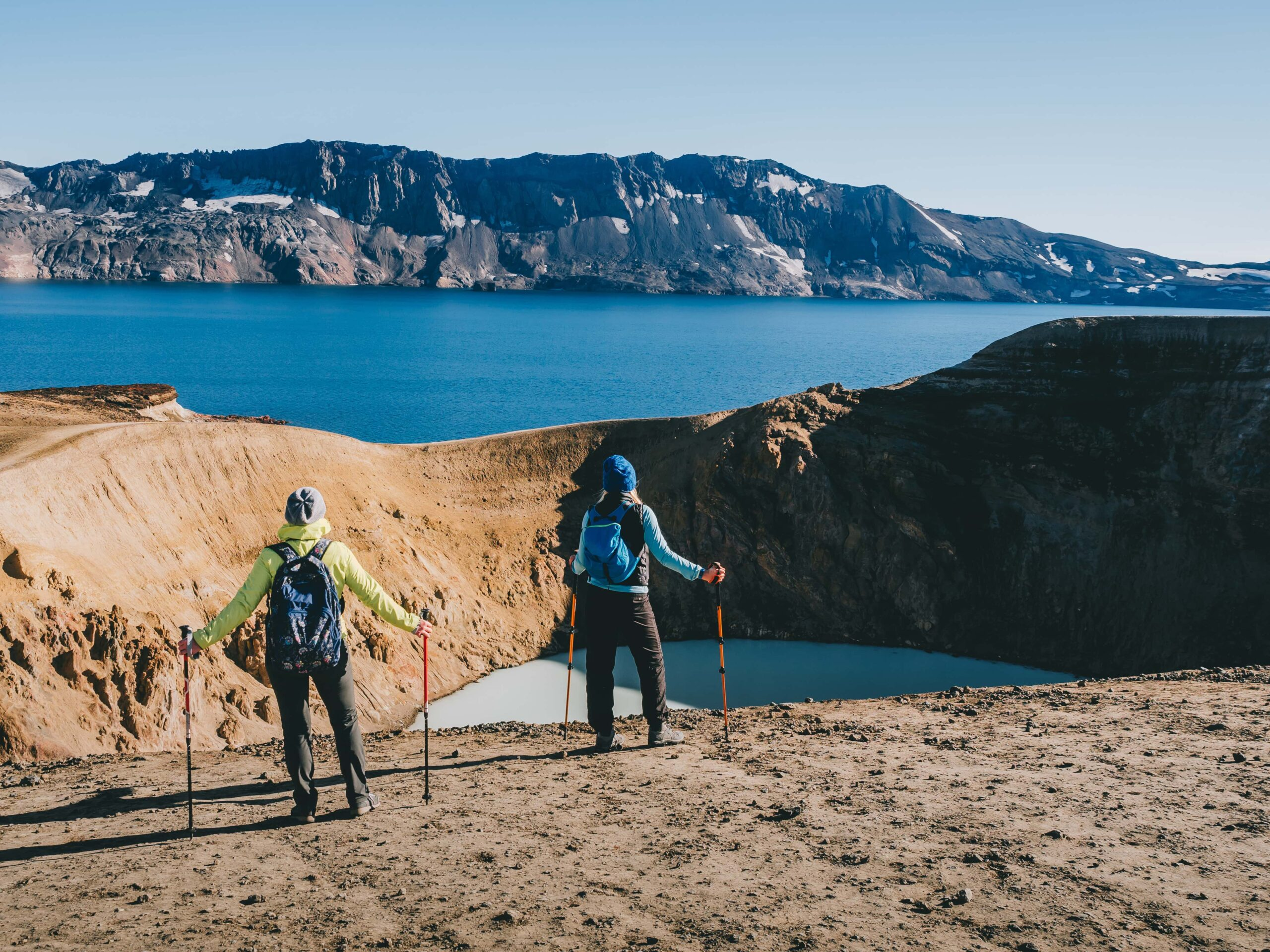 two people hiking at Askja Crater in the highlands of Iceland