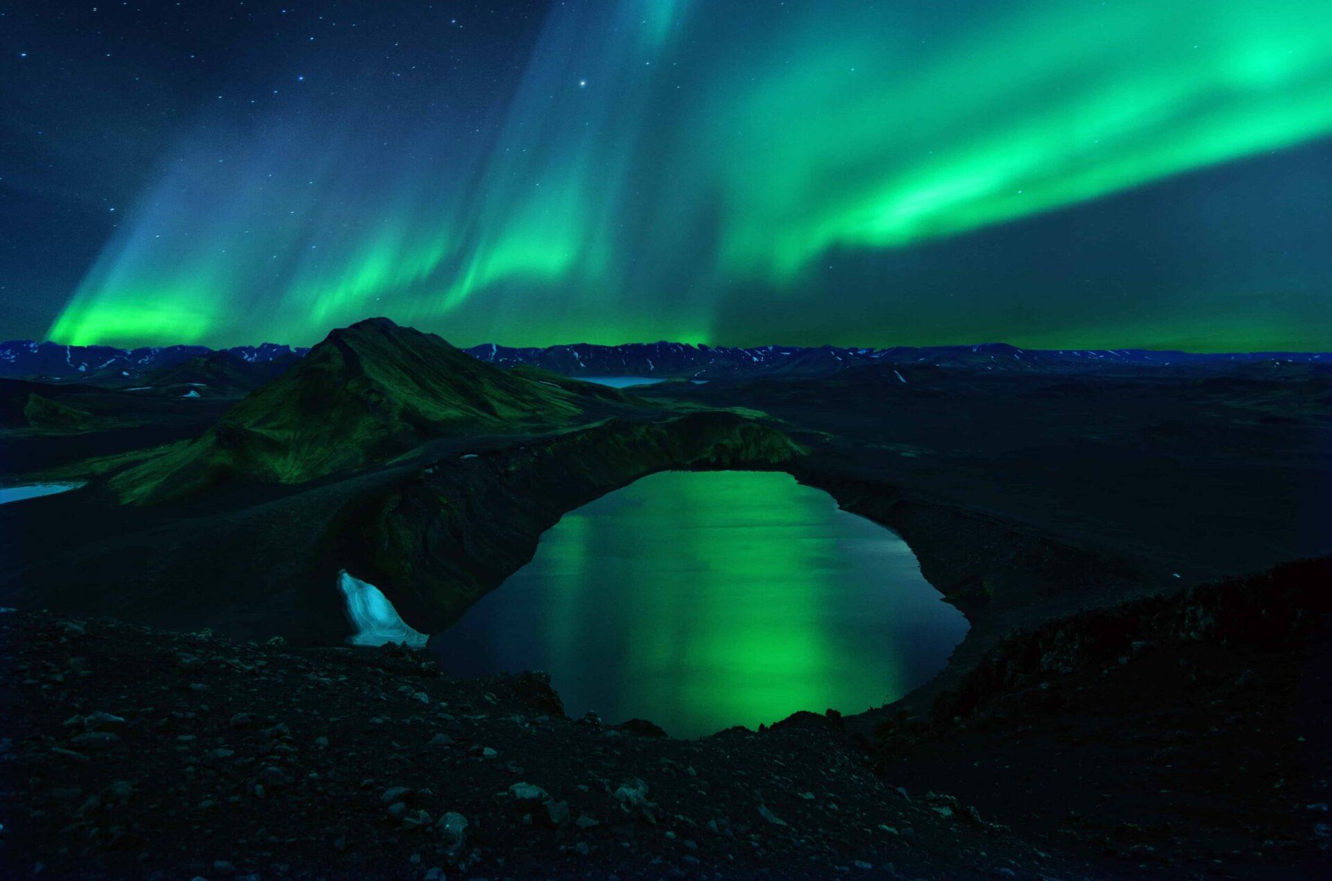 northern lights over Ljotipollur in Landmannalaugar highlands of Iceland